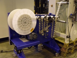 Moving roll spool for welding web
