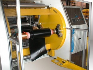Automatic winder for extruded or calendared rubber - width up to 1600 mm - diameter 1200 mm