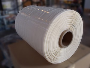 Spool of adhesive foam - Web width :  5 to 15 mm